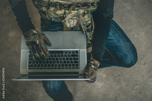 Photo  Terrorist  hacking data network.