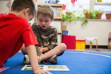 Students Reading In A Kindergarten Classroom.