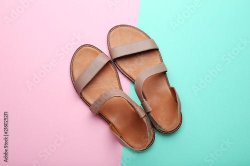 Fototapeta Female beige sandals on colorful background obraz