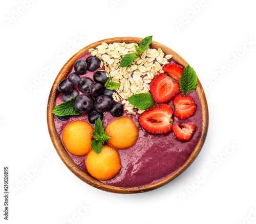 Bowl with tasty acai smoothie on white background, top view