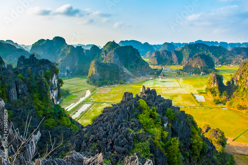 Foto op Aluminium Groen blauw Beautiful sunset landscape viewpoint with green rice fields from the top of Mua Cave mountain, Ninh Binh, Tam Coc in Vietnam