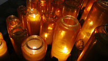 Candles Burning In Glass Jars