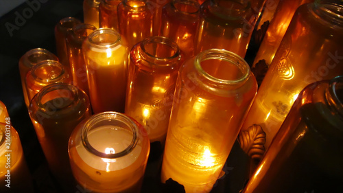Candles burning in glass jars Canvas Print