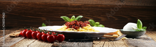Leinwand Poster Plate of delicious spaghetti Bolognaise or Bolognese with savory minced beef