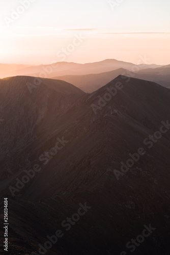 Foto op Aluminium Chocoladebruin A purple and pink landscape view of the Rocky Mountains during sunrise.