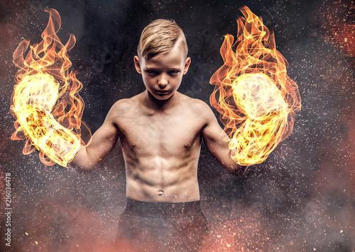 Young shirtless boy boxer w...