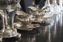 Silver Jugs Stand On The Table.