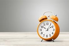 Orange Retro Alarm Clock On Wo...