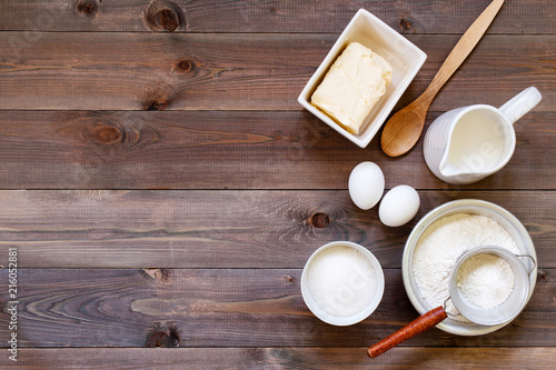 Poster Produit laitier Wooden brown background with ingredients for baking