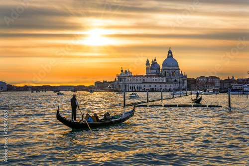 Tuinposter Gondolas Grand Canal with gondolas in Venice, Italy. Sunset view of Venice Grand Canal. Architecture and landmarks of Venice. Venice postcard