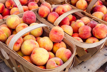 Baskets Of Peaches At A Farmer's Market