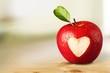 Leinwandbild Motiv Red apple with a heart shaped