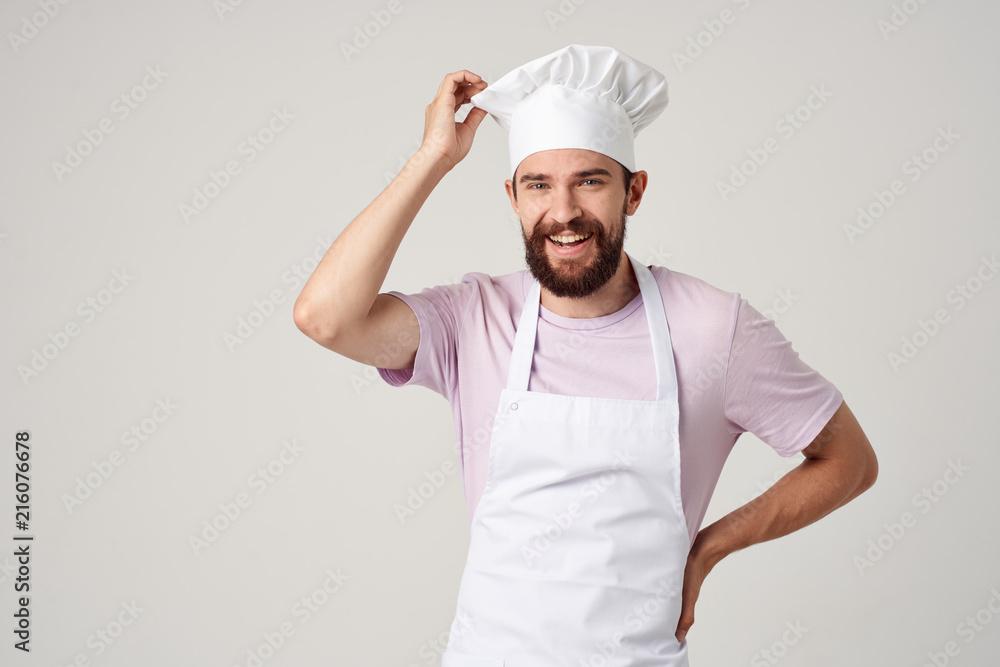 Fototapeta man in a pink tank top with hat and vest