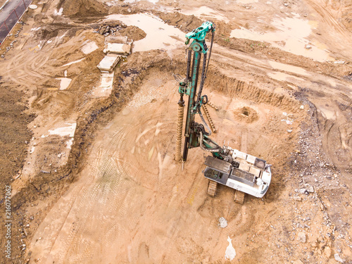 hydraulic machine for drilling wells and installing piles at construction site