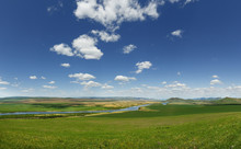 View Of A River In The  Grassland Of The Countryside Of Mongolia