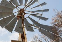Aged Windmill On Farm