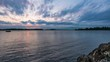 TL Voyageurs - Campsite Rock Sunset Falls Over Rainy Lake