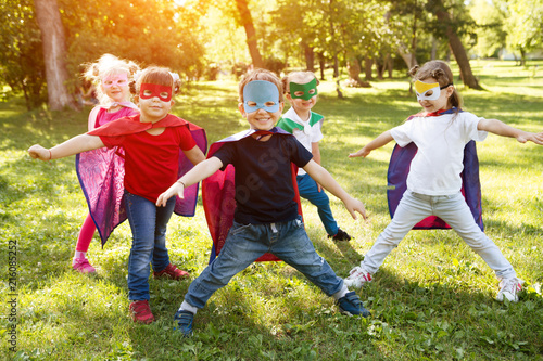 Group kids friends Superhero playing togetherness and having fun outdoor..