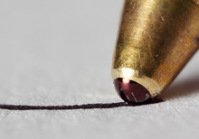 Extreme Macro Photo Of Pen Writing To Paper.