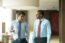 Serious Indian Businessman Sharing His Problems With Coworker. Upset Young Entrepreneur Talking To Coworker. Serious Conversation Concept