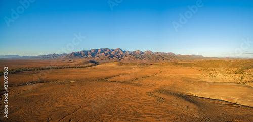 Papiers peints Desert de sable Aerial panorama of Flinders Ranges at orange sunset in South Australia