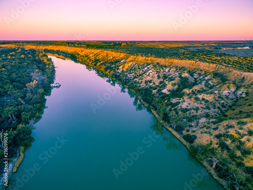 Aerial landscape of sandstone cliffs and Murray RIver at sunset