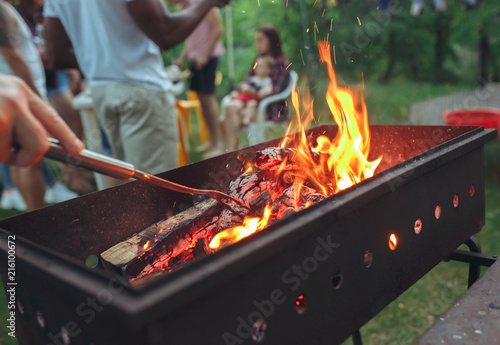 Photo Stands Grill / Barbecue warm fireplace with lots of trees ready for barbecue