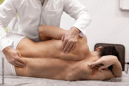 Cuadros en Lienzo Orthopedist examining patient in hospital