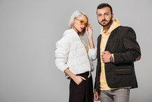 Couple Of Models In Autumn Jackets Posing Isolated On Grey Background