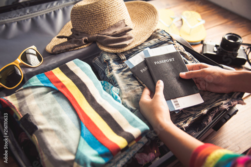Fotografering  People holding passports, map for travel with luggage for the trip