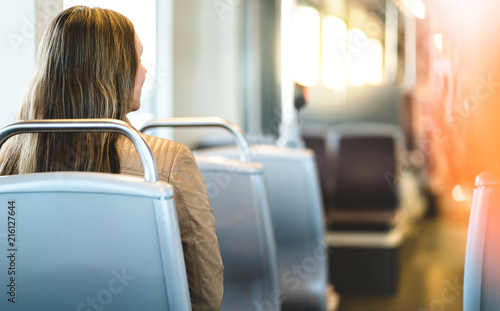 Tablou Canvas Back view of young woman sitting in public transportation