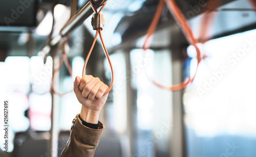 Papel de parede Hand holding the handle in tram, train, bus or subway