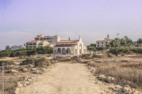 Foto op Canvas Cyprus The road to a small stone white church on the beach