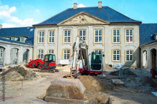 Street renovation by historical building Fototapeta