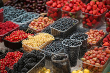 Containers With Different Ripe Berries At Market