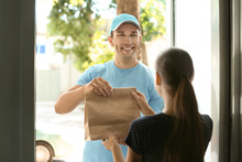Young Man Delivering Food To C...