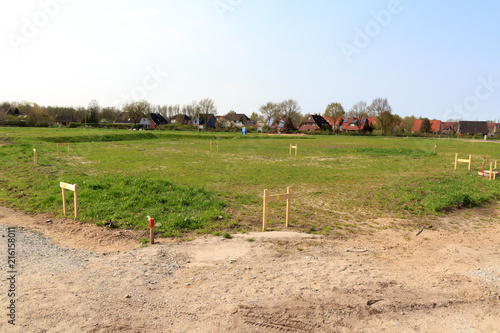 Obraz Building lot site with grass after stakeout measurement survey ready for construction, Germany - fototapety do salonu