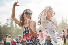 Friends Dancing With Arms Rais...