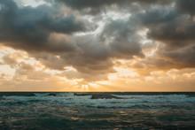 Sun Setting Over Stormy Sea