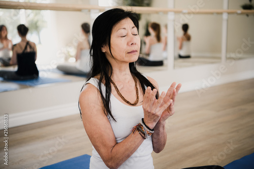 Woman in yoga pose, mirror in background