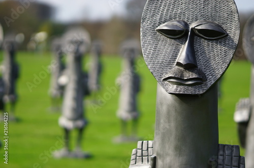 Valokuva Statue or sculpture of weird faces in a garden, photo taken in Yorkshire Sculptu