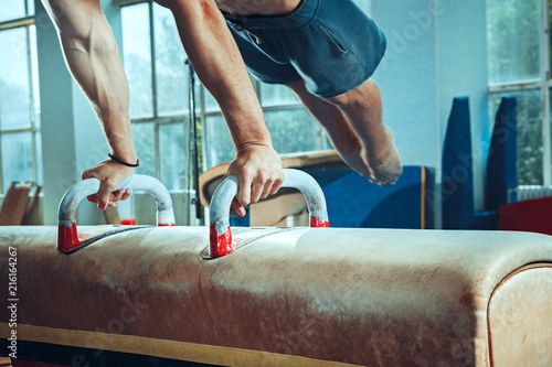 Keuken foto achterwand Gymnastiek The sportsman during difficult exercise, sports gymnastics