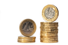 Stack Of Euro Coins And New Pound Coins Isolated On White Background