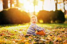Little Baby Boy With Pumpkin I...