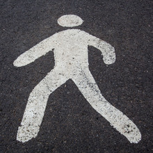 A White Pedestrian Sign On The...