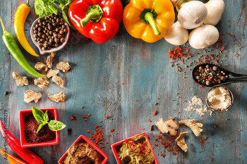 Fotografie, Obraz  Frame made of different spices and vegetables on wooden background