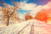 Country Road Covered With Snow In Winter