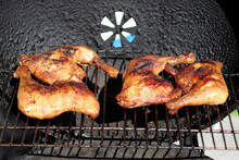Grilled Quarter Chicken Thighs And Legs On The BBQ.