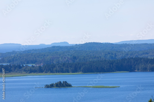 Valokuva  The the island in the Ladoga lake in Russia with the mountains and the forest on