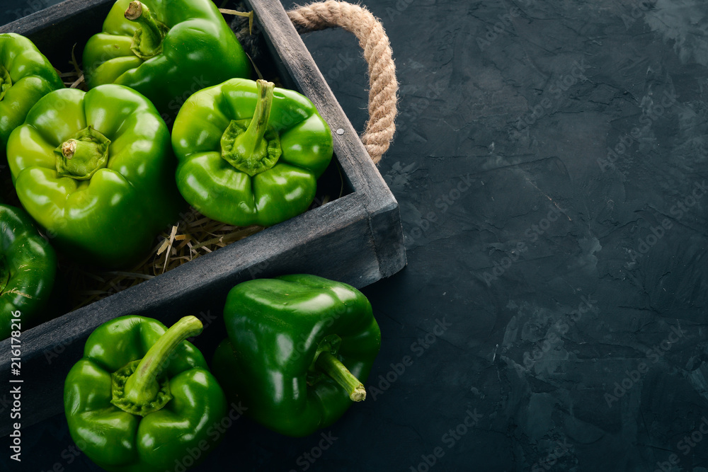 Fototapety, obrazy: Fresh green pepper in a wooden box. Organic food. Top view. Free space for text.